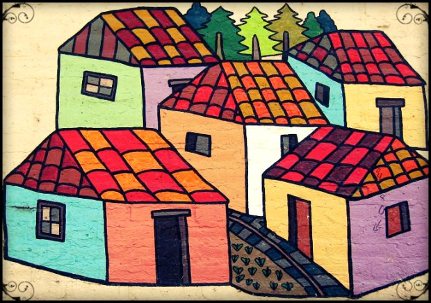 Mural with different colored houses in La Palma, El Salvador