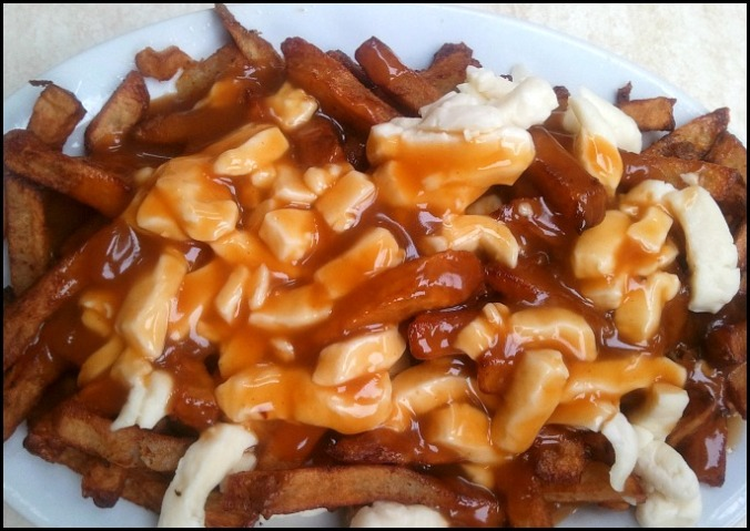 Poutine, Quebec, fries with gravy and cheese curds, typical food, greasy spoon, foodie, food porn, food photos, photography, travel, Travellersoul76