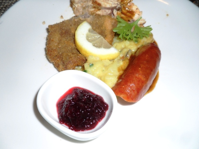 Viking Cruises, Viking Atla, Austrian food, food, foodie, schnitzel, mashed potatoes, sausage, cranberry sauce, Austrian themed, dinner, photography, TS76