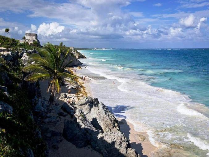 Tulum Ruins facing the Caribbean Sea in Tulum, Mexico. A must see in the Riviera Maya.