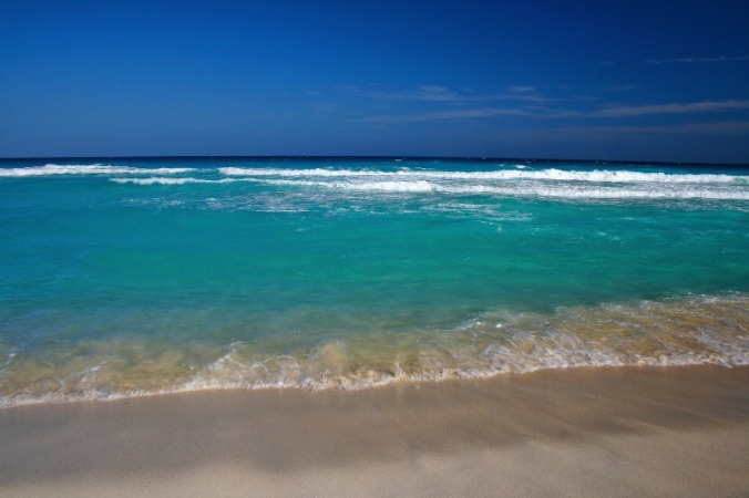 Life sure is better at the beach. Cancun, Mexico has many public beaches where you can enjoy views such as this.