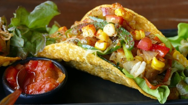 Feed your senses with delicious and colorful Mexican food with traditional tacos which are a must.