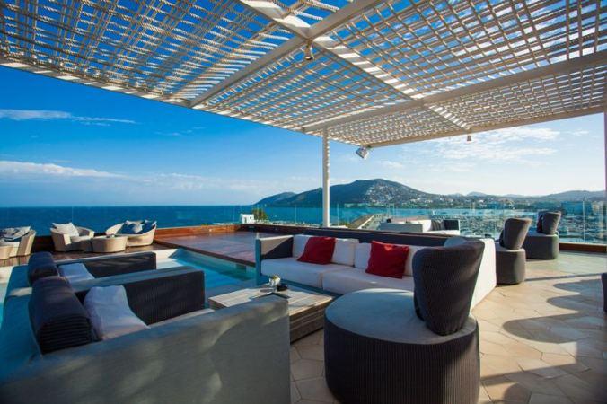 Outdoor terrace at Agua de Ibiza luxury hotel overlooking the marina and Mediterranean