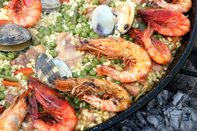 Love seafood? Then you must tantalize your tastebuds with the one and only Paella, a typical feast in Spain and around the world. Rice is cooked with all types of seafood and is delicious.