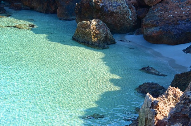 Blessed by nature. Rocks and turquoise water in Ibiza.