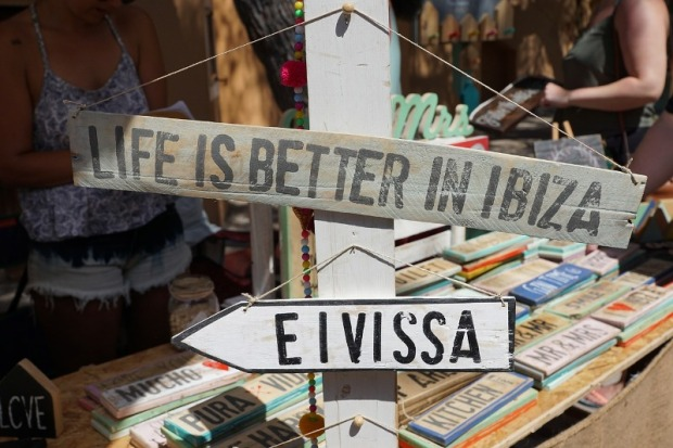 Life is better in Ibiza or Eivissa. Wooden signs on sale at a local store.