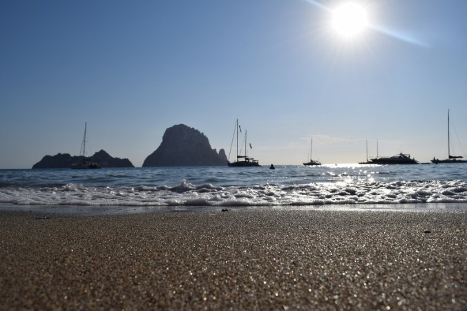 View of boats and the sea from a beach in Ibiza