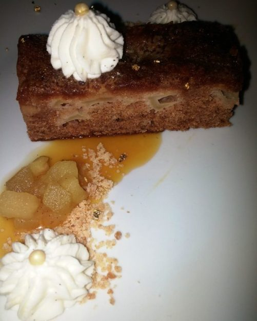 Apple cake with whisky caramel sauce and whipped cream at Auberge Saint-Gabriel in Old Montreal. Delicious right?