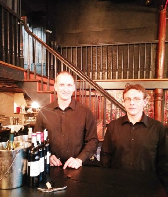 Dominic and François, serving customers at Auberge Saint-Gabriel in Old Montreal.