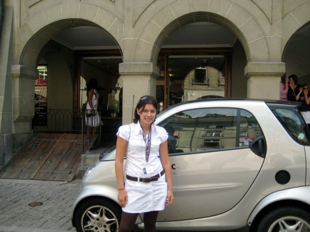 Posing with a Smart Car in Europe. Laura Vaisman, author of Spiritual Nomad book. #travel #photography #travelphotography